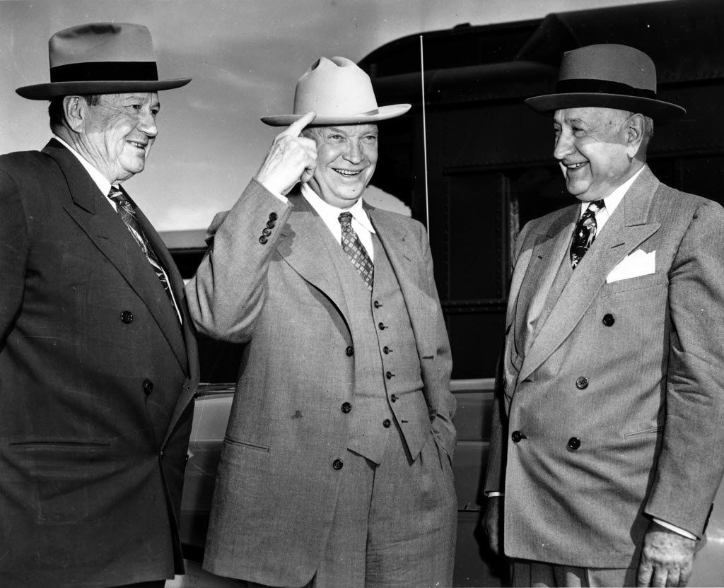 Gen. Dwight D. Eisenhower (center) said he was in Fort Worth to take off his shoes and sit around in his socks with two old friends, oilman Sid Richardson (left) and publisher Amon Carter (right).  He was on a stopover on his way to College Station where he would speak at Texas A&M College.