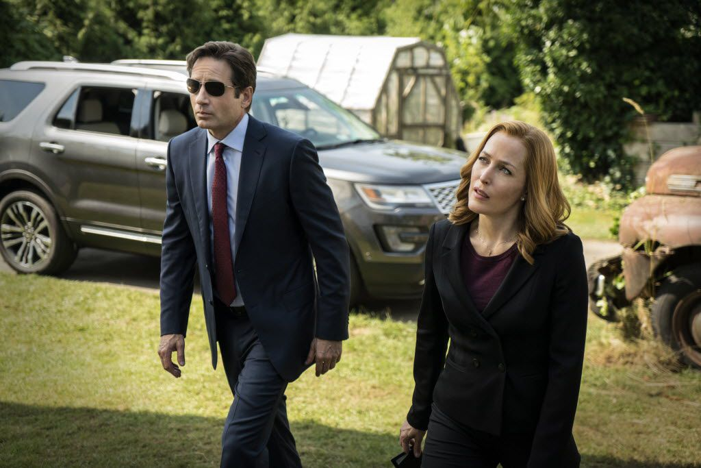 David Duchovny, left, as Fox Mulder and Gillian Anderson as Dana Scully in The X-Files.