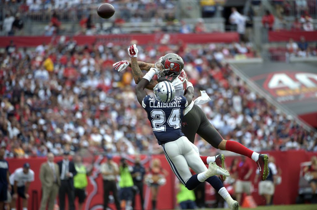 Dallas Cowboys cornerback Morris Claiborne (24) knocks away a pass Tampa Bay Buccaneers wide receiver Mike Evans (13) during the first half of an NFL football game in Tampa, Fla., Sunday, Nov. 15, 2015. (AP Photo/Phelan M. Ebenhack)