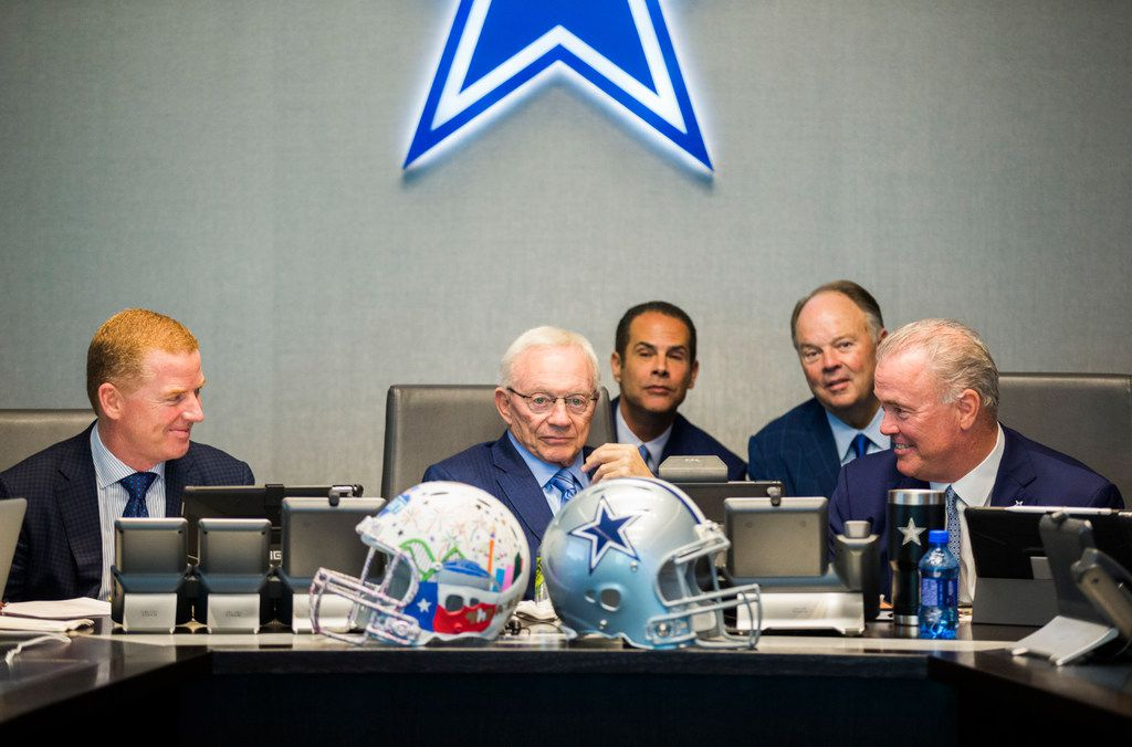 """Cowboys owner Jerry Jones (center), head coach Jason Garrett (left), executive vice president Stephen Jones (right) and other team executives wait to make their first-round pick in the """"war room"""" on Thursday, April 26, 2018, at The Star in Frisco. (Ashley Landis/The Dallas Morning News)"""