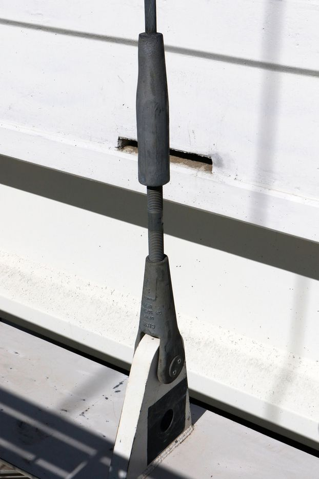 Cables and rods attached near the pedestrian and bike lane of the Margaret McDermott bridge