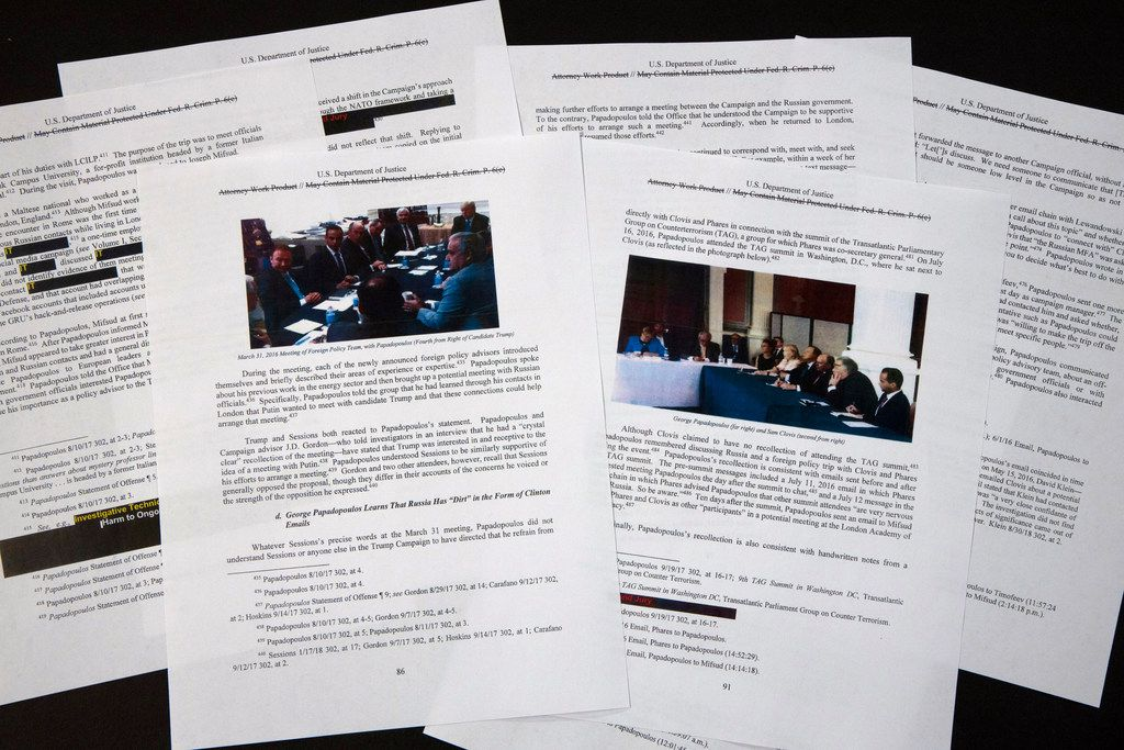 Special counsel Robert Mueller's redacted report on the investigation into Russian interference in the 2016 presidential election is photographed Thursday, April 18, 2019, in Washington. The photos in the report show George Papadopoulos and others in meetings.