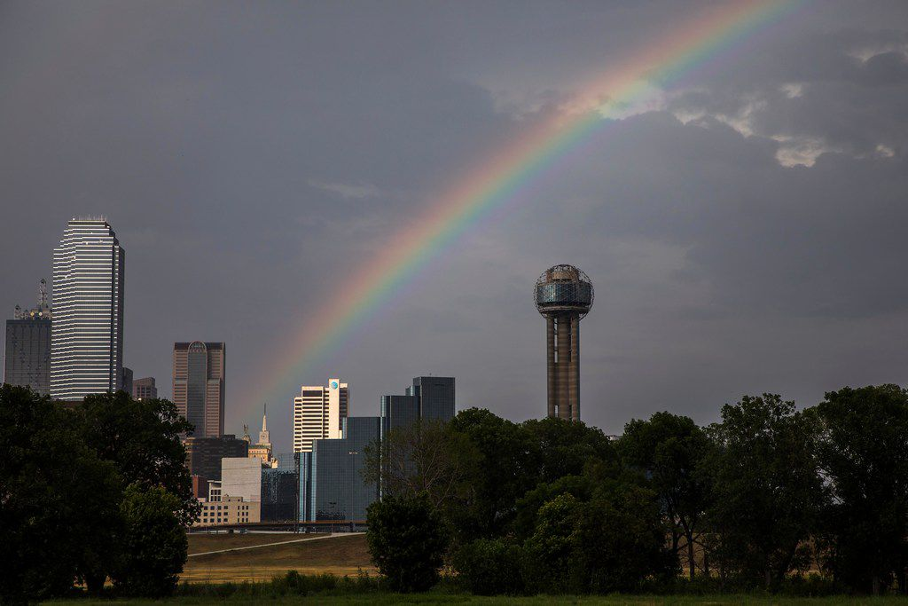 Afternoon showers give way to a rainbow over downtown on Monday, July 9, 2018, in Dallas. (Smiley N. Pool/The Dallas Morning News)  [ reunion tower, bank of america tower, mercantile building ]