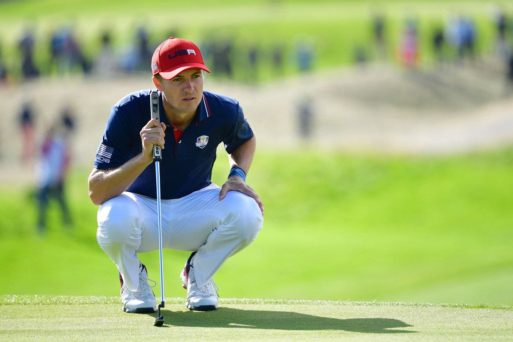 Jordan Spieth of the U.S. team lines up a putt during singles matches of the 2018 Ryder Cup.