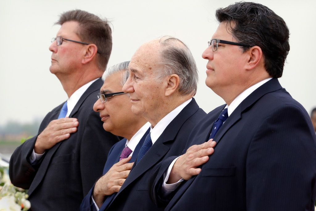 From left: Sugar Land Mayor Joe Zimmerman; Dr. Barkat Fazal, president of the Ismaili National Council U.S.A.; the Aga Khan, and Texas Secretary of State Rolando Pablos during the playing of national anthems.