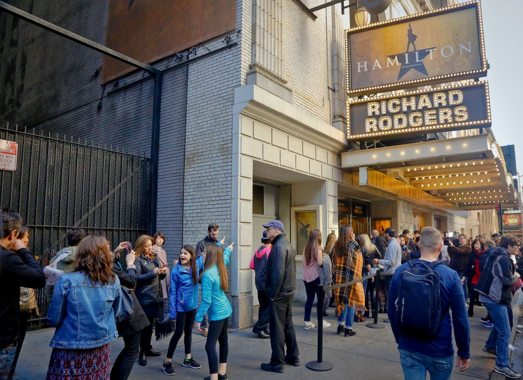 In this 2016 file photo, people line up to see the Broadway play Hamilton in New York.