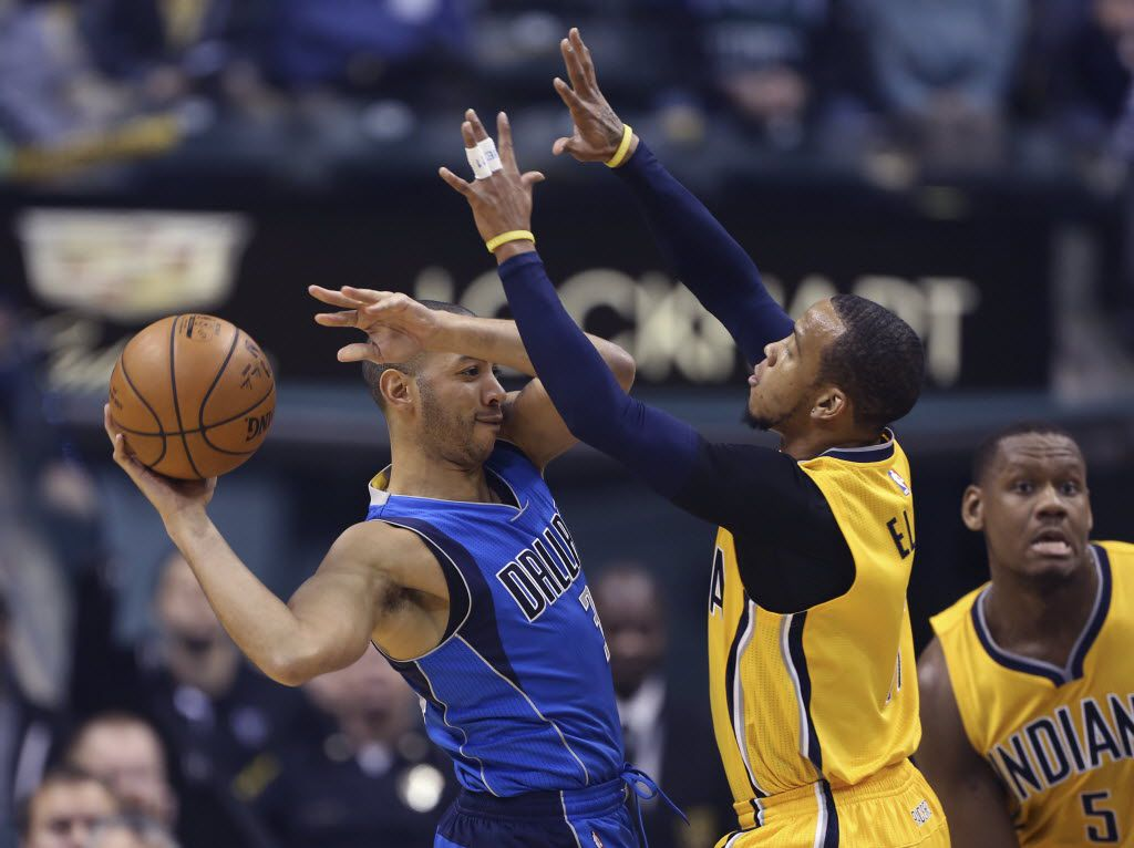 Dec 16, 2015; Indianapolis, IN, USA; Dallas Mavericks guard Devin Harris (20) is guarded by Indiana Pacers guard Monta Ellis (11) during the first half at Bankers Life Fieldhouse. Mandatory Credit: Brian Spurlock-USA TODAY Sports