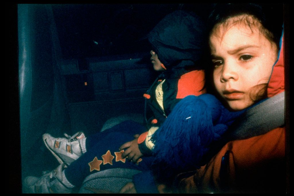 Two children being escorted from the compound. Twenty-one children left the compound during the standoff. At least 17 died.