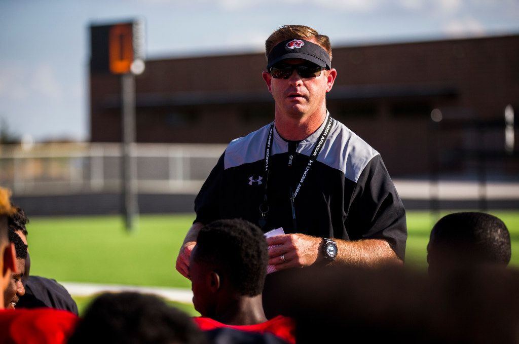 FILE - Denton Braswell head coach Cody Moore talks to his team after a practice on Tuesday, Oct. 27, 2016, at Braswell High School in Aubrey. (Ashley Landis/The Dallas Morning News)