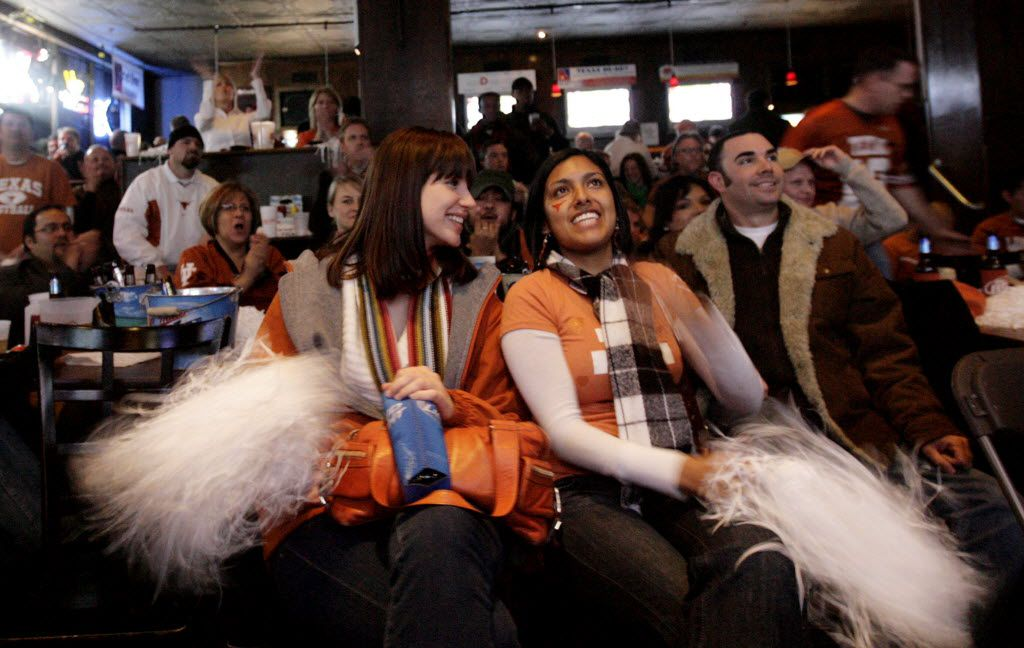 Cagney Wollenman, left, and Cristina Ramirez,  UT graduates watch football at Knox Street Pub in Dallas, Texas.