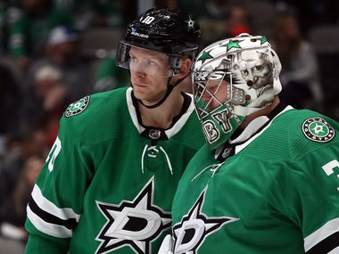 DALLAS, TEXAS - OCTOBER 29:  (L-R)  Corey Perry #10 of the Dallas Stars talks with Anton Khudobin #35 of the Dallas Stars during play against the Minnesota Wild in the second period at American Airlines Center on October 29, 2019 in Dallas, Texas. (Photo by Ronald Martinez/Getty Images)