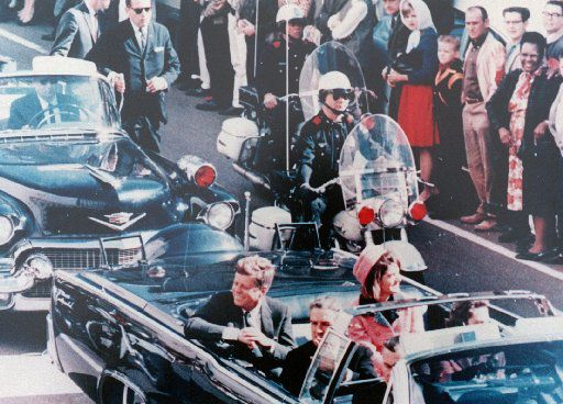 Officer Bobby Hargis (in sunglasses) rides patrol in the presidential motorcade ion Nov. 22, 1963, moments before John F. Kennedy was shot.