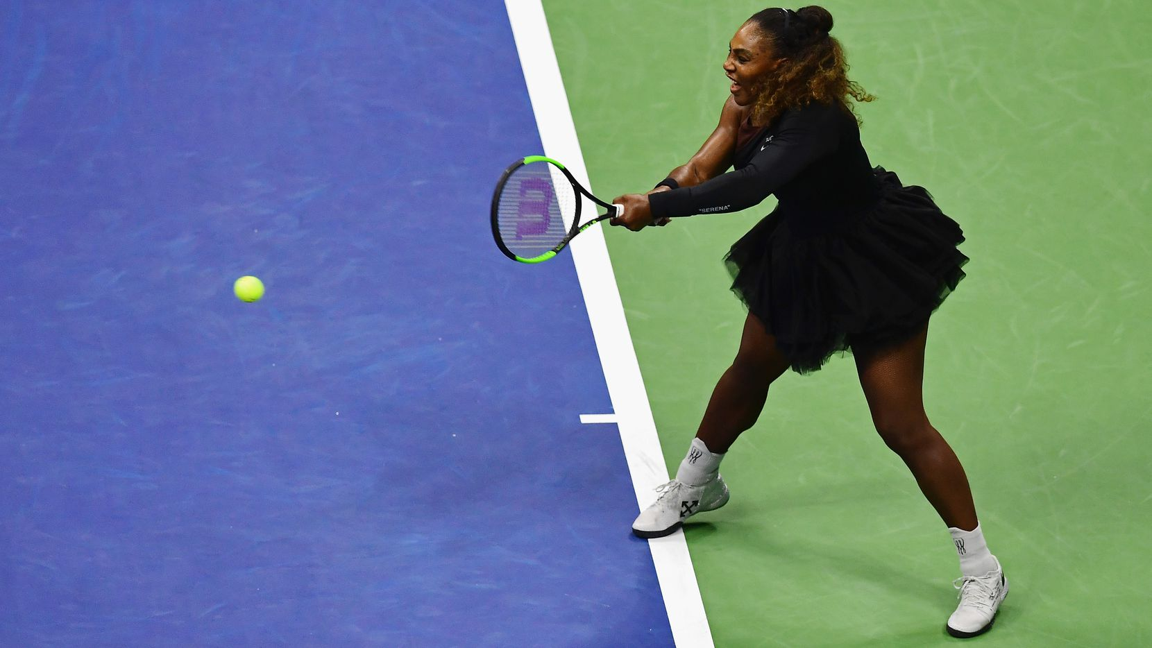 Serena Williams returns the ball during her women's singles first round match against Magda Linette of Poland on Day One of the 2018 US Open at the USTA Billie Jean King National Tennis Center.