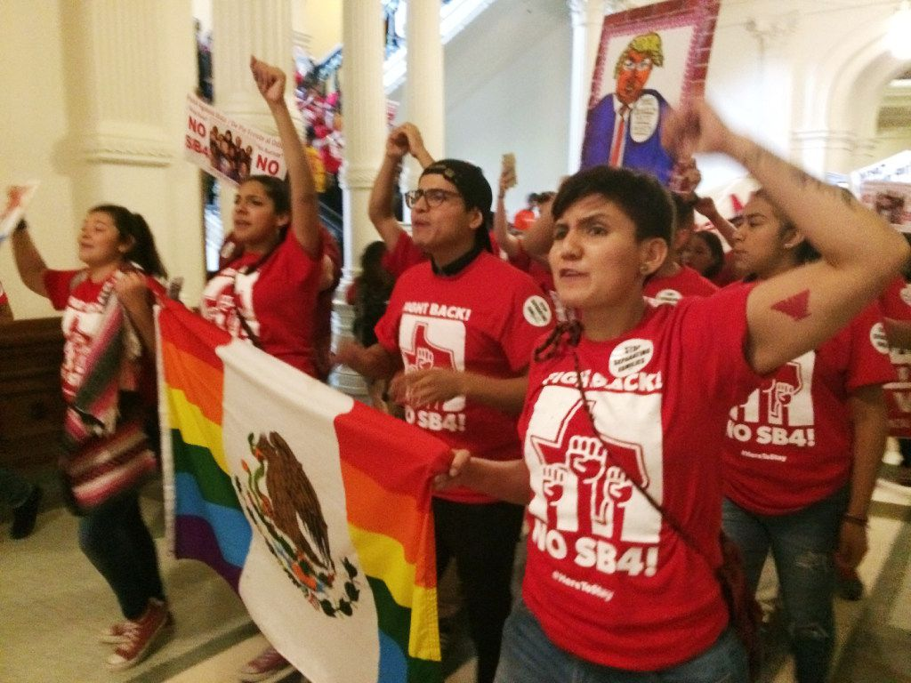 """Demonstrators in the Texas Capitol protest the state's newly passed anti-sanctuary cities bill. Opponents call Texas' anti-sanctuary cities law a """"show your papers"""" law since it empowers police to inquire about peoples' immigration status during routine interactions."""