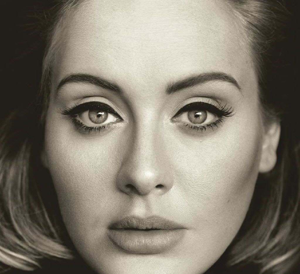 """This CD cover image released by Columbia Records shows """"25,"""" the latest release by Adele. Adele's """"Hello"""" single has become the first song to sell one million tracks in a week. Her comeback track sold 1.11 million digital songs, setting a new record. The album will be released on Nov. 20."""