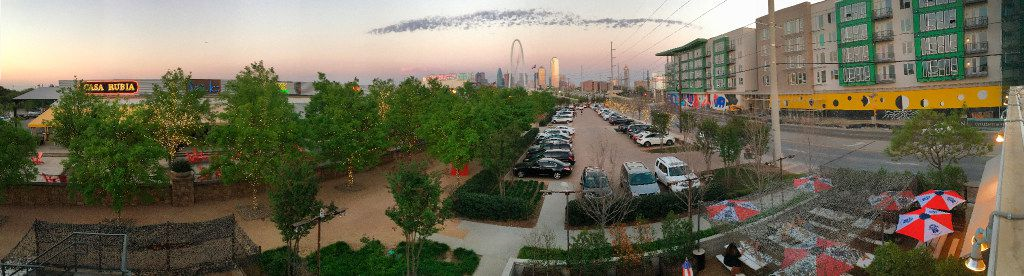 The Margaret Hunt Hill Bridge and the Dallas skyline are seen from the rooftop of Off-Site Kitchen in the Trinity Groves area of West Dallas, Wednesday, March 22, 2017.  The Cypress at Trinity Groves luxury apartments (right) are under construction across Singleton Boulevard.