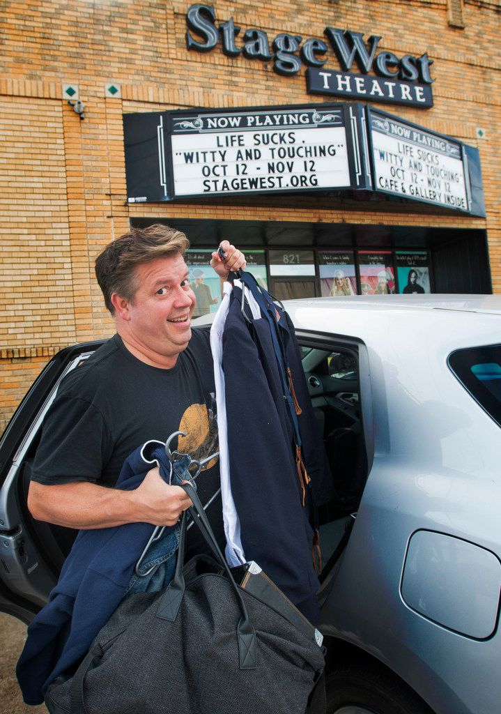 Actor B.J. Cleveland removes his bags, clothing, costume and makeup kit from his car after arriving at Stage West Theatre in Fort Worth, Texas on Nov. 18, 2017.