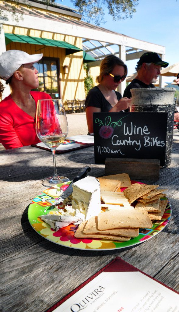 Bikers enjoy a tasting at Quivira Vineyards, known for its biodynamic farming practices.