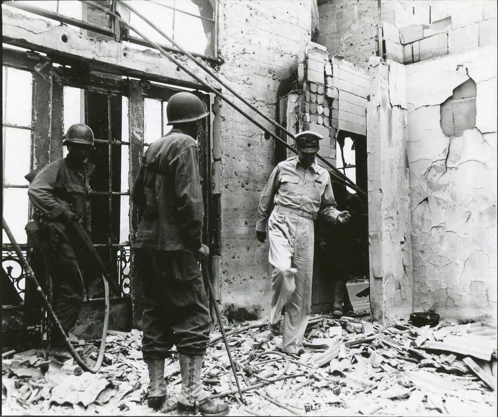 Gen. Douglas MacArthur returns to the ruins of his home atop the once-luxurious Manila Hotel on Feb. 23, 1945. From Rampage: MacArthur, Yamashita and the Battle of Manila, by James M. Scott.