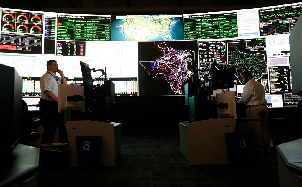 System operators work in the command center of the Electric Reliability Council of Texas in Taylor, Texas on Tuesday, May 15, 2018. About 90 percent of Texas' electric load is managed by ERCOT. (Vernon Bryant/The Dallas Morning News)