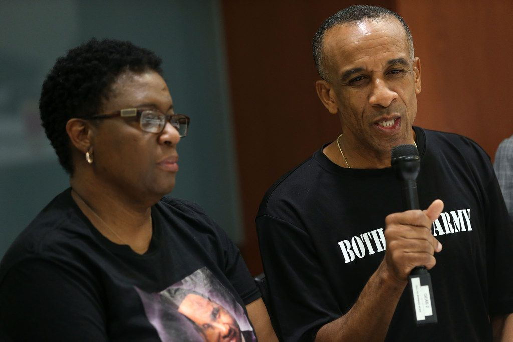 Bertrum Jean, the father of Botham Jean, speaks next to his wife Allison Jean during an interview in Dallas on Tuesday with The Dallas Morning News. Botham Jean was shot and killed in his apartment by Dallas police officer Amber Guyger. She was arrested on a manslaughter charge and later fired.