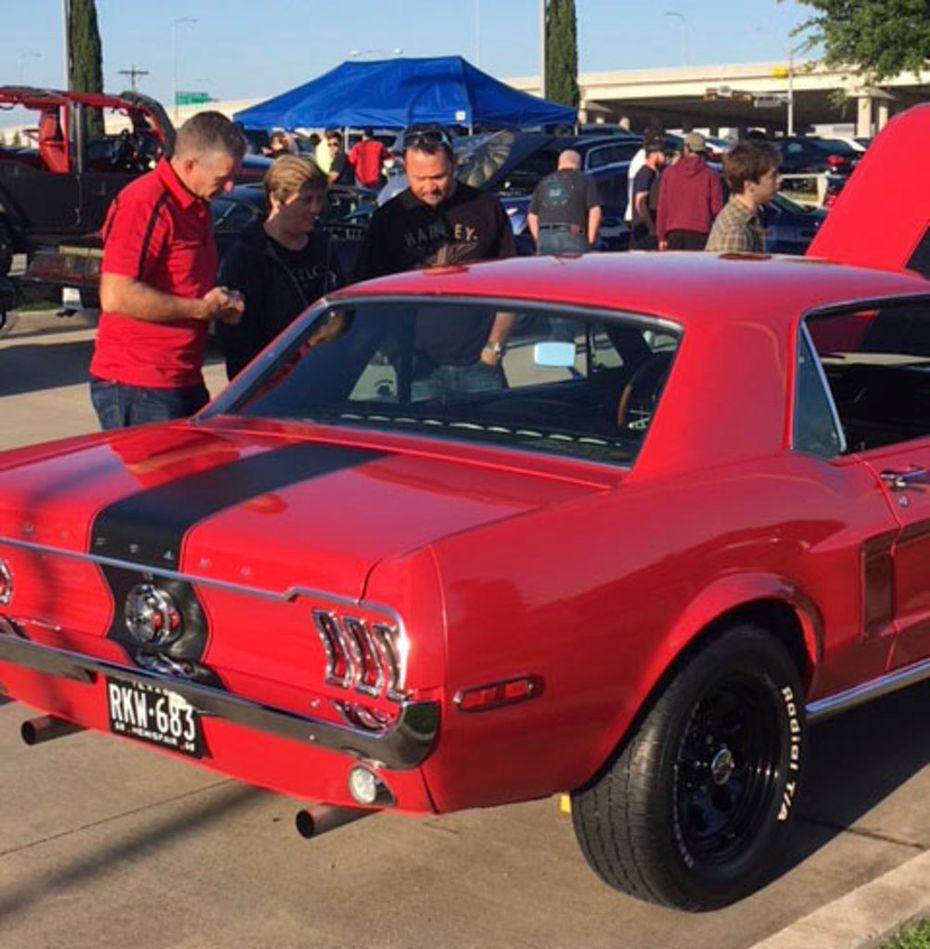 Car enthusiasts check out a 1968 Ford Mustang coupe with 302 V8 engine belonging to Chris Casten at Cars & Coffee in Plano. Cars & Coffee's last event at Classic BMW in Plano is Dec. 1, 2018.