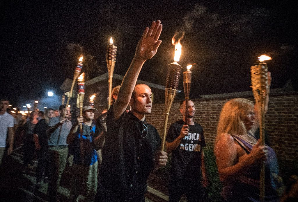 """Chanting """"White lives matter!"""" """"You will not replace us!"""" and """"Jews will not replace us!"""" several hundred white supremacists carrying torches marched through the University of Virginia campus on Aug. 11, 2017. President Trump was widely criticized for failing to condemn the marchers, saying the clashes with counterprotesters involved blame on both sides."""