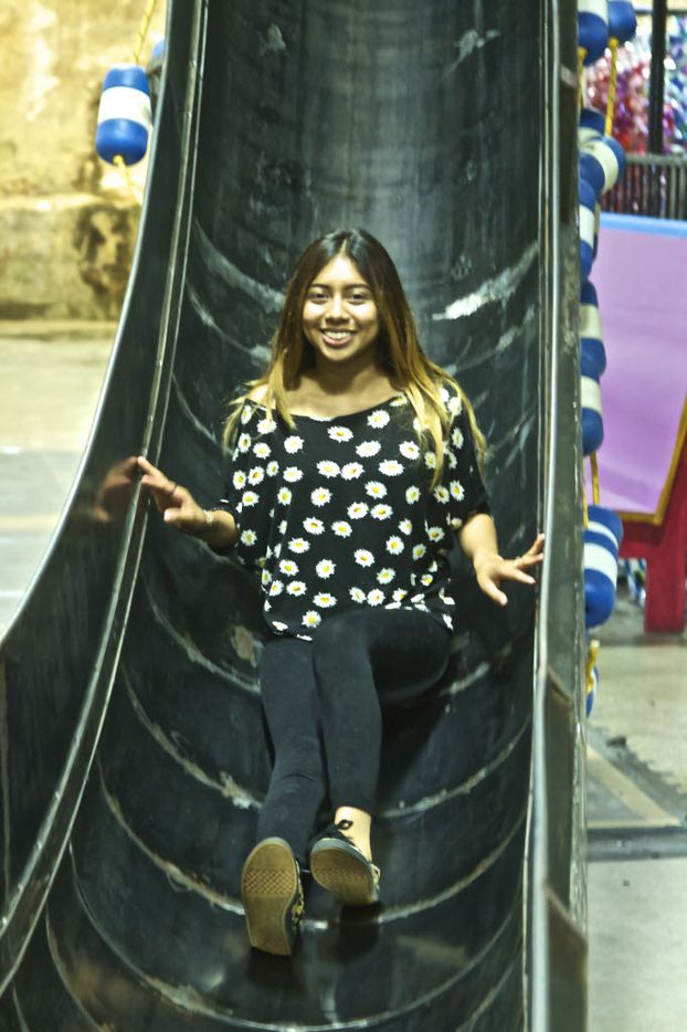 Maria Ramirez slides down the Giant Slide, the most popular attraction at SPARK! Adventures in Creativity, located in Dallas. Ramirez is a high school student at North Dallas High School.