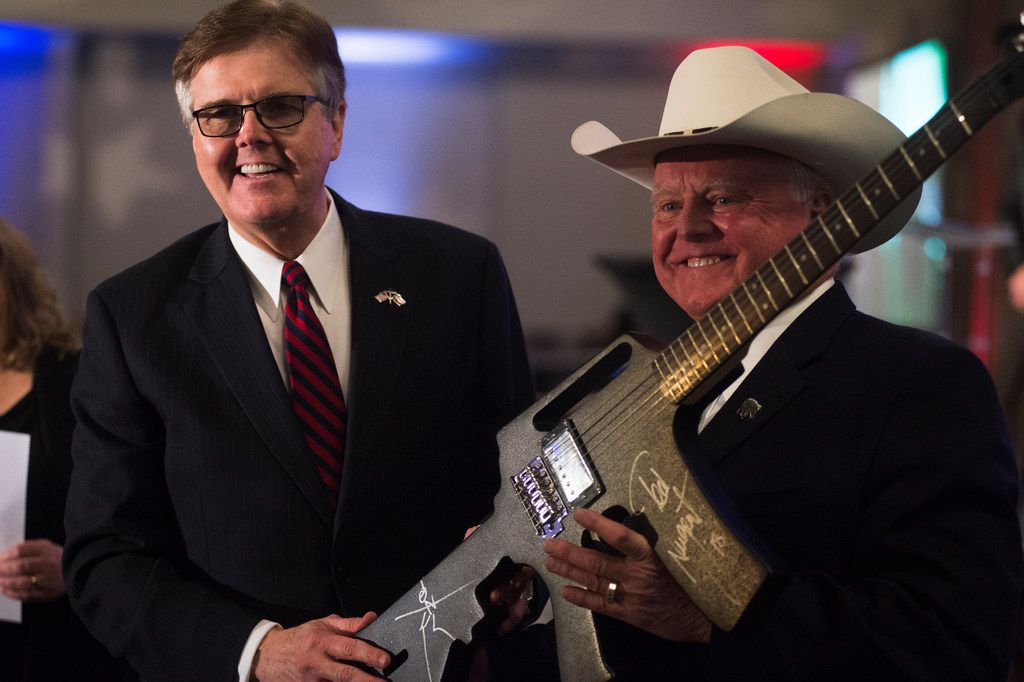 Texas Lt. Gov. Dan Patrick (left) receives a gun-shaped guitar, signed by Ted Nugent, after winning the live auction for approximately $3,000. The Denton County Republican Party's 39th annual Lincoln Reagan Dinner took place Saturday evening at the Embassy Suites by Hilton Denton Convention Center. The keynote speaker for the event was former Alaska Gov. Sarah Palin.