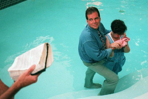 Flip Benham, director of Operation Rescue National, baptizes Norma  McCorvey , who was Roe in the Roe V. Wade case that  established abortion rights in the nation in a Garland swimming pool.