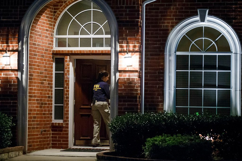Members of an FBI evidence response team enter the family home of Sherin Mathews in the 900 block of Sunningdale in Richardson.