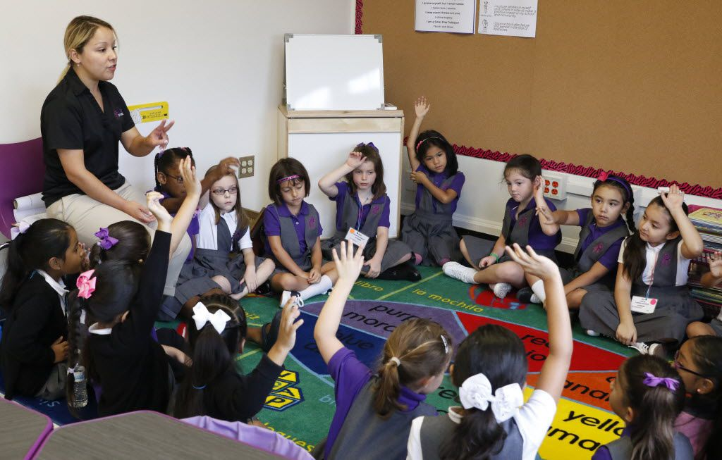 Claudia Capetillo, first grade teacher, left, talks to her students on the first day of school at Solar Preparatory School for Girls in Dallas, Monday, August 22, 2016.  Solar Preparatory School for Girls is the district's first attempt at a socio-economically balanced campus, with 50 percent of its students qualifying for free and reduced lunch and the other 50 percent who don't. (David Woo/The Dallas Morning News)