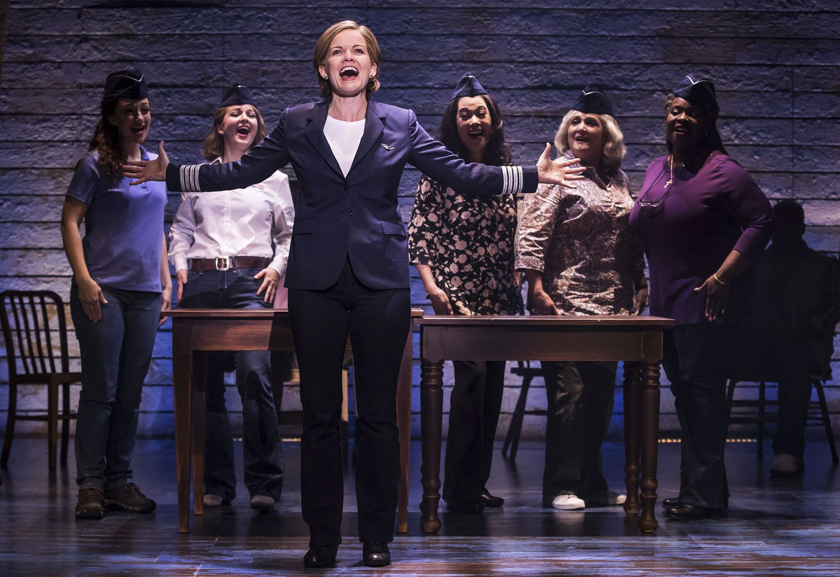 A scene from Come from Away, which is coming to Bass Performance Hall in Fort Worth. The photo, taken in 2018 during the first North American tour of the show, shows Becky Gulsvig (front center) and (background, from left) Megan McGinnis, Emily Walton, Christine Toy Johnson, Julie Johnson and Daniele K. Thomas.