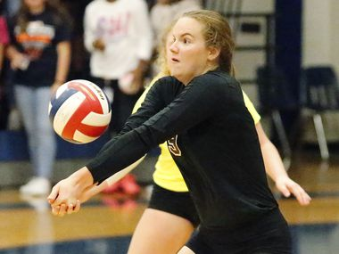 Wylie High School Ana Heath (9) fields a serve during game two as Sachse High School hosted Wylie High School in a district 10-6A volleyball match on Friday night, October 15, 2019. (Stewart F. House/Special Contributor)