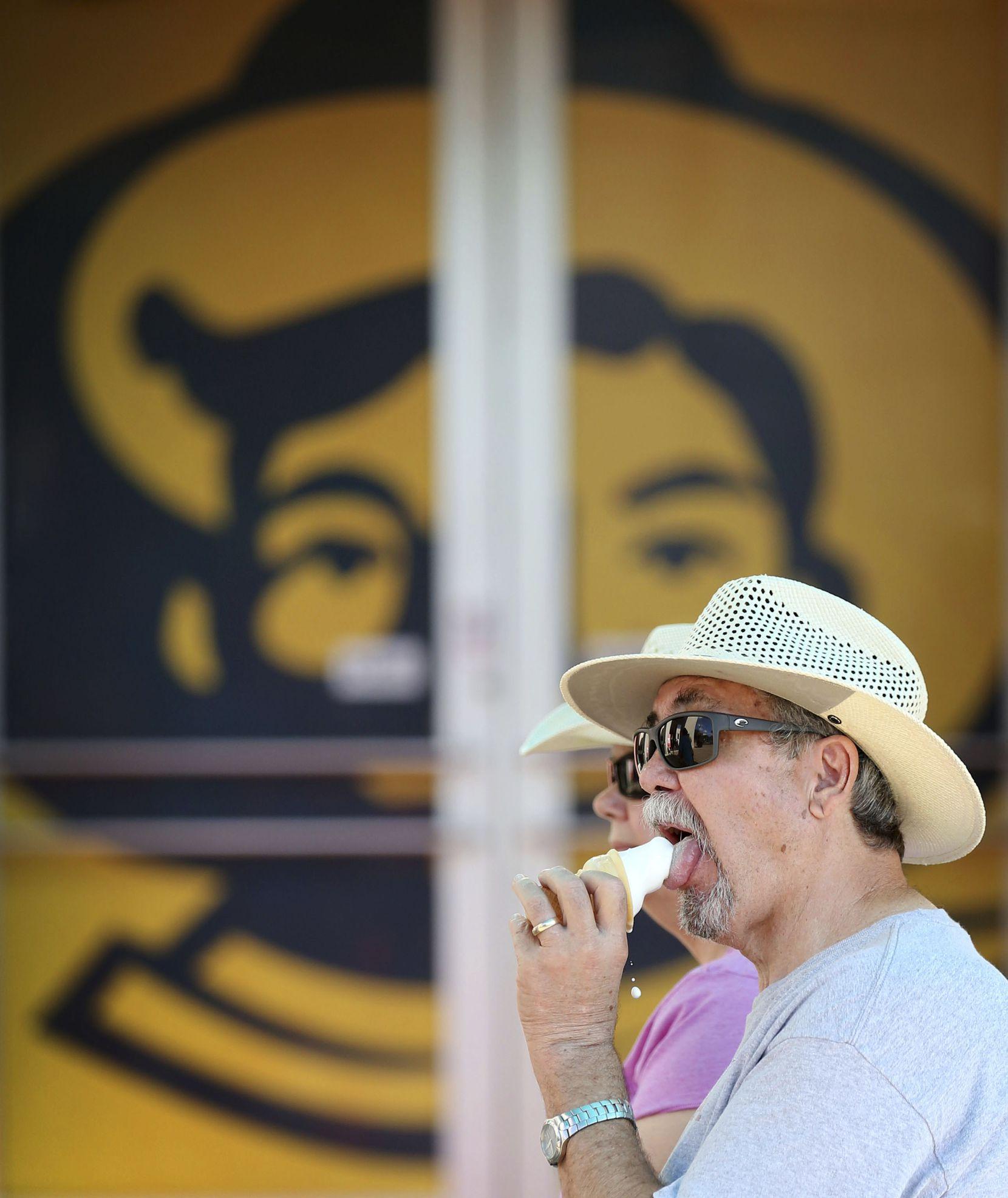 Steve Bradshaw eats an ice cream cone at the State Fair of Texas at Fair Park in Dallas on senior citizen day, Thursday, Oct. 4, 2018.