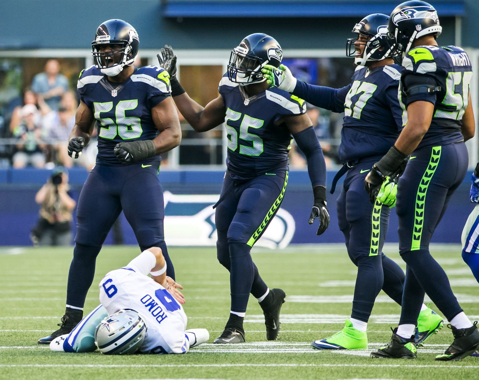 Seahawks defensive lineman Cliff Avril celebrates his sack on Cowboys quarterback Tony Romo on the third play of the game as the Seattle Seahawks take on the Dallas Cowboys for a preseason game at CenturyLink Field in Seattle Thursday August 25, 2016. Romo sustained a broken bone in his back when he was hit from behind by Seattle's Cliff Avrill and slid awkwardly on the third play of a preseason game. (Bettina Hansen/The Seattle Times)
