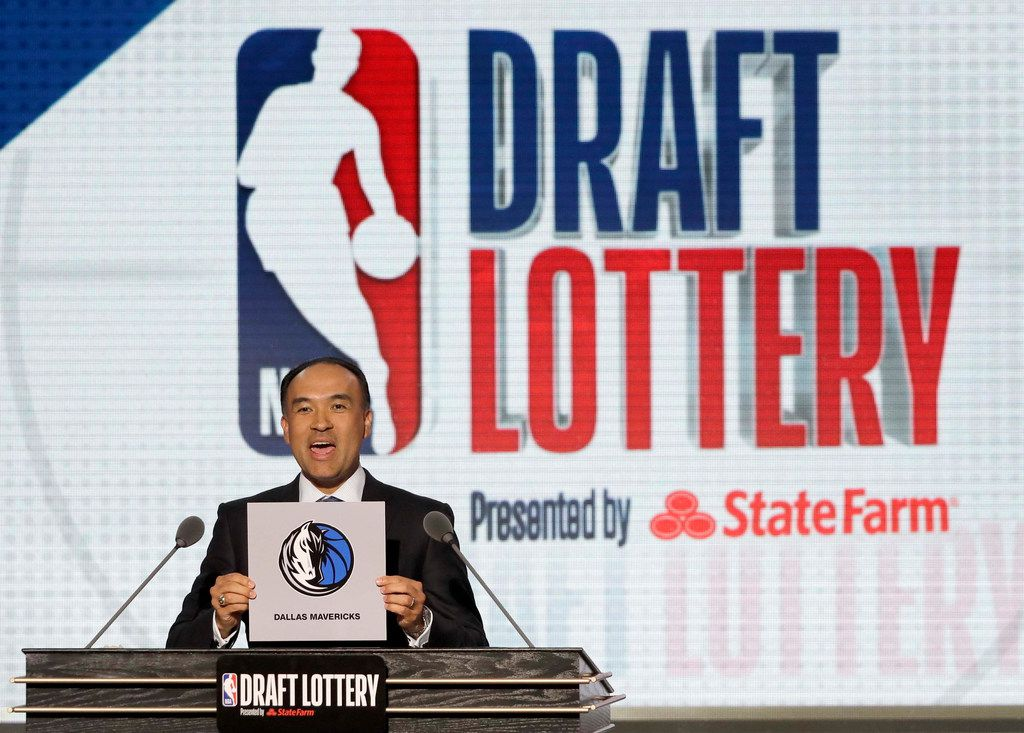 NBA Deputy Commissioner Mark Tatum announces that the Dallas Mavericks had won the fifth pick during the NBA basketball draft lottery Tuesday, May 15, 2018, in Chicago. (AP Photo/Charles Rex Arbogast)