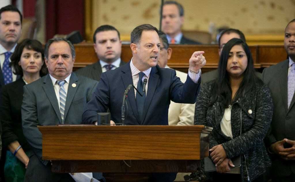 """Rep. Rafael Anchia, D-Dallas, speaks against SB 4, the sanctuary cities ban, in the House chamber on Thursday.  The Texas House gave final approval Thursday to a bill banning """"sanctuary cities."""" (Jay Janner/Austin American-Statesman via AP)"""