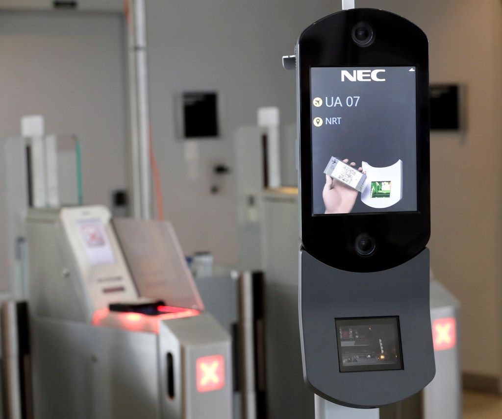 FILE - A U.S. Customs and Border Protection facial recognition device is ready to scan another passenger at a United Airlines gate at George Bush Intercontinental Airport in Houston. (AP Photo/David J. Phillip, File)