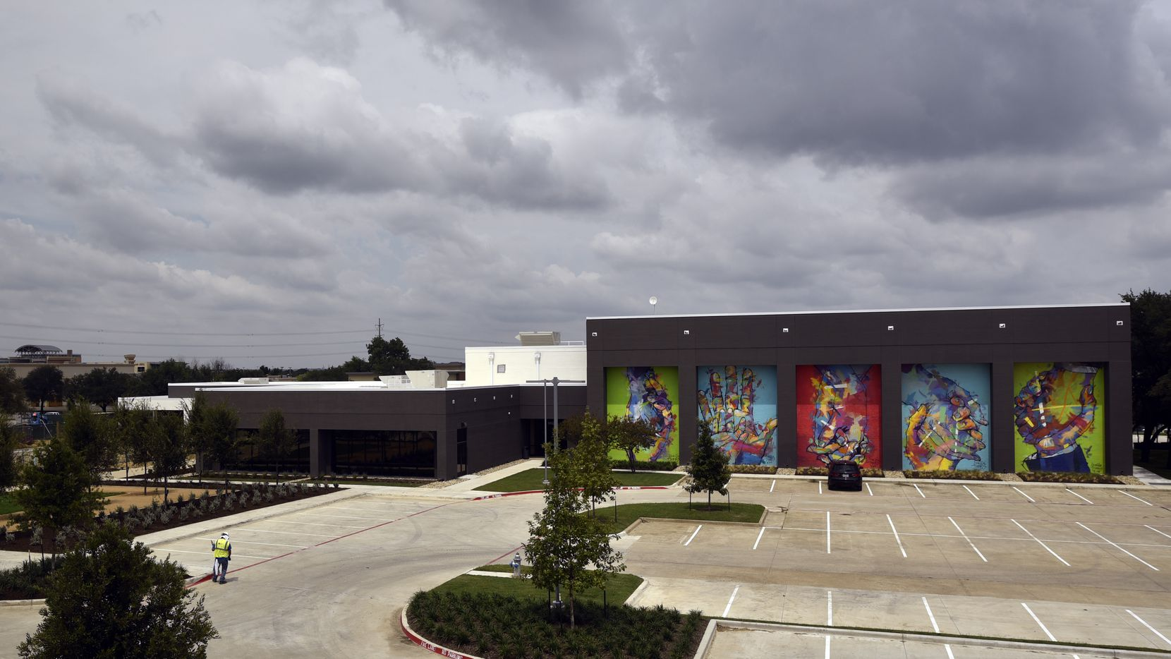Murals by Spanish artist Adrian Torres decorate the fitness center (right) on the campus of Legacy Central in Plano.