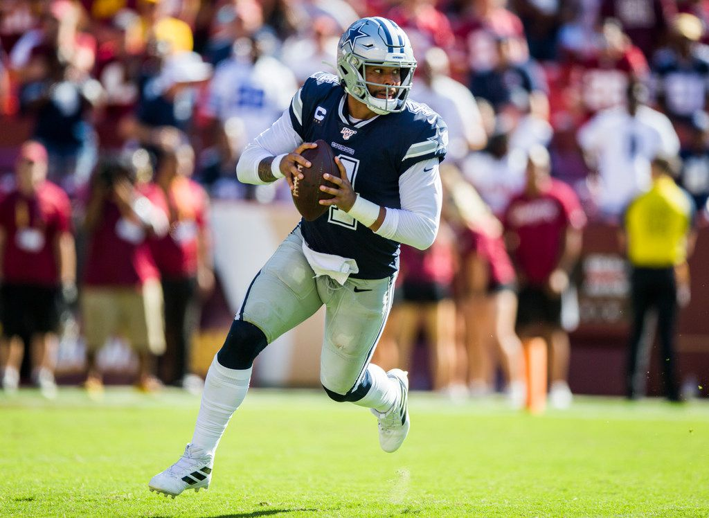 Dallas Cowboys quarterback Dak Prescott (4) looks for a receiver during the fourth quarter of an NFL game between the Dallas Cowboys and the Washington Redskins on Sunday, September 15, 2019 at FedExField in Landover, Maryland.