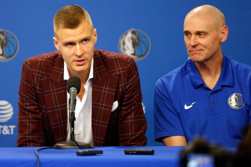 Dallas Mavericks forward Kristaps Porzingis (6) answers a question as Dallas Mavericks head coach Rick Carlisle looks on during a press conference at American Airlines Center in Dallas on Monday, February 4, 2019. (Vernon Bryant/The Dallas Morning News)