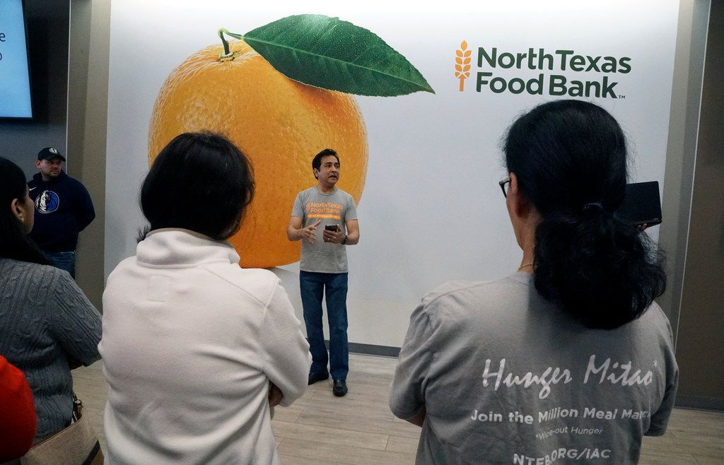 Raj Asava speaks to more than 100 volunteers at North Texas Food Bank in Plano. (Lawrence Jenkins/Special Contributor)