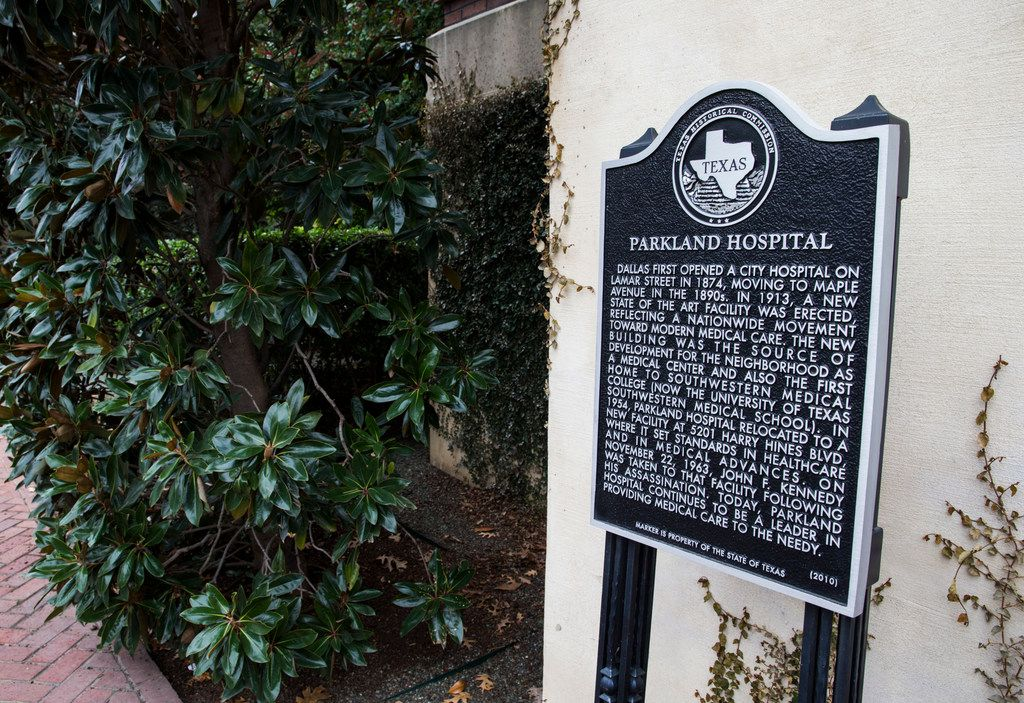 A historic marker is posted outside the original hospital building at Old Parkland on Wednesday, January 10, 2018 in Dallas. The original hospital and nurses quarters were converted to office space, and several new buildings have been added to the complex. (Ashley Landis/The Dallas Morning News)