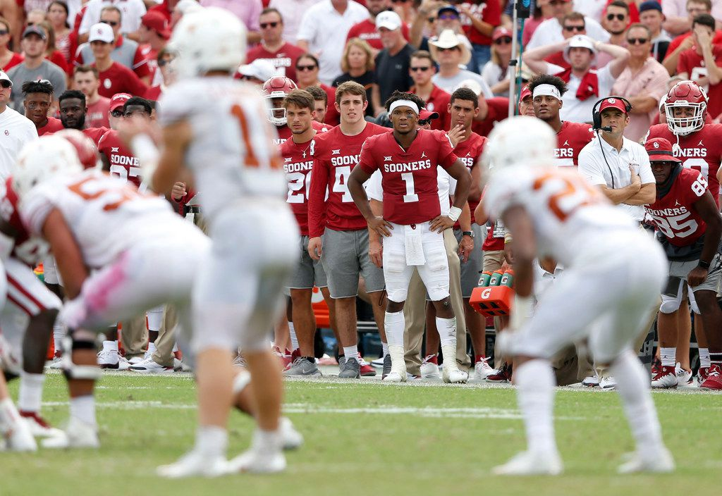 Oklahoma Sooners quarterback Kyler Murray (1) watches as Texas Longhorns quarterback Sam Ehlinger (11) prepares to run a play during the second half of play at the Cotton Bowl in Dallas on Saturday, October 6, 2018. Texas Longhorns defeated Oklahoma Sooners 48-45. (Vernon Bryant/The Dallas Morning News)