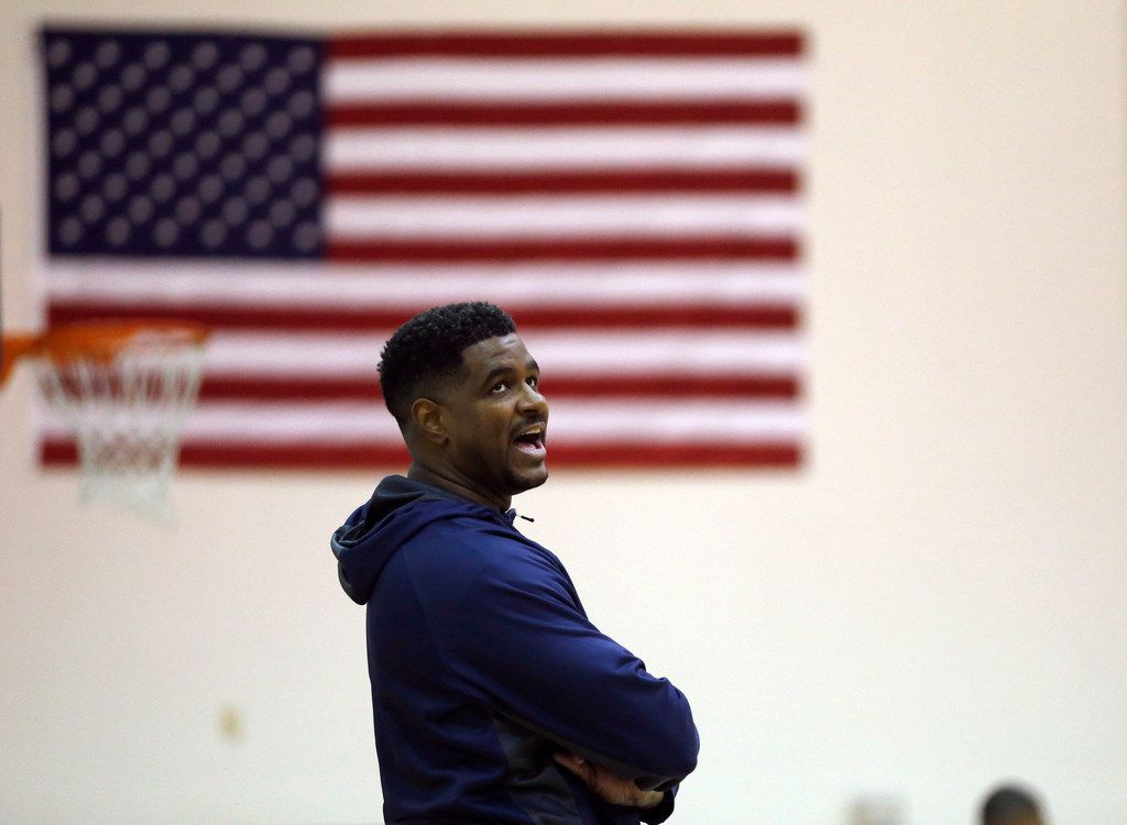 Athletic director and head coach Brandon Thomas talks to his players as they run a drill during practice at Oak Cliff Faith Family Academy in Dallas on Wednesday, March 6, 2019. Faith Family Academy will be competing in the 4A boys basketball state tournament this weekend. (Vernon Bryant/The Dallas Morning News)
