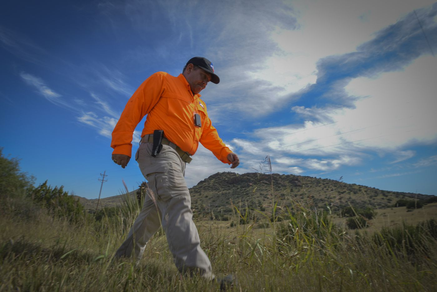Kelley Janysek, of Texas Search and Rescue searches the rugged Brewster County terrain on Saturday, Oct. 22, 2016 for Zuzu Verk.