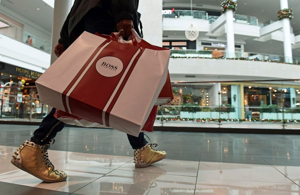 FILE- In this Dec. 22, 2017, file photo, people shop at the Pentagon City Mall in Arlington, Va. On Thursday, March 1, 2018, the Commerce Department issues its January report on consumer spending. (AP Photo/Susan Walsh, File)