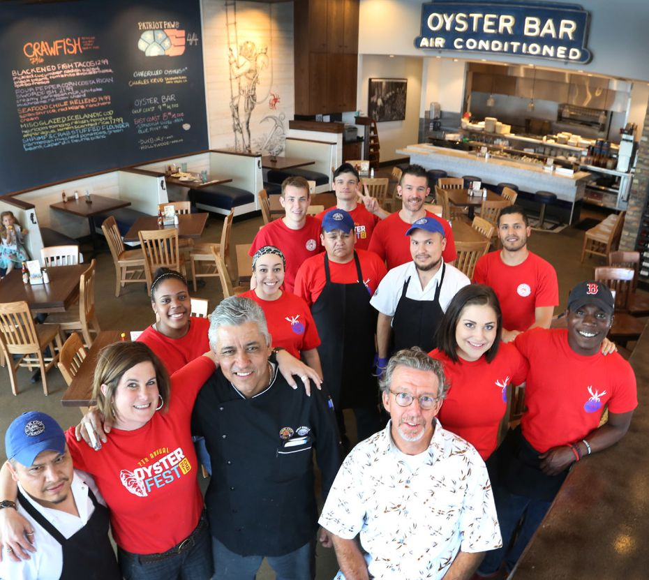 Bill Bayne of Fish City Grill poses with the crew of the restaurant located at 1415 East Renner Road in Richardson, Texas.  (Louis DeLuca/The Dallas Morning News)