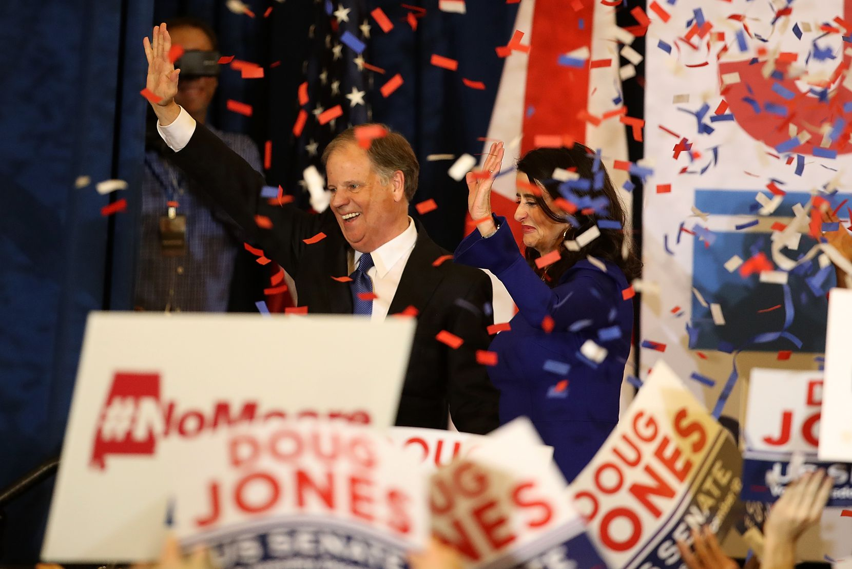 Sen.-elect Doug Jones and his wife, Louise Jones, greet supporters during his election night gathering Tuesday at the Sheraton Hotel in Birmingham, Ala. Jones, a Democrat, defeated Roy Moore, the Republican candidate dogged by sexual misconduct accusations, to claim the U.S. Senate seat vacated when Jeff Sessions became attorney general.